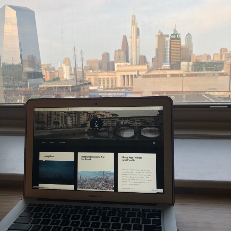 Blogging with Philadelphia skyline.