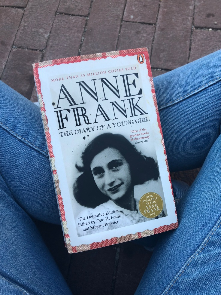 Reading Anne Frank's diary as I wait to enter the Anne Frank House.